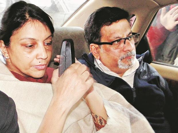 Nupur Talwar (left) with her husband, Rajesh Talwar. (Photo: PTI)