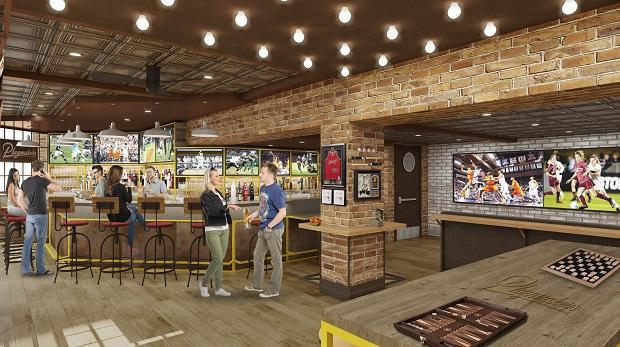 A rendering of the Playmakers Sports Bar & Arcade onboard the Symphony of the Seas; the Oasis-class ship at the STX shipyard in France; the ship under construction