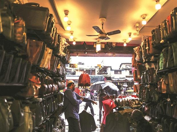 A vendor waits for a customers at a leather goods store in Dharavi. Photo: Bloomberg