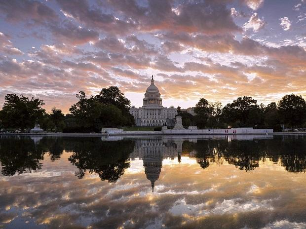 The sun rises above the US Capitol building in Washington. Photo: PTI