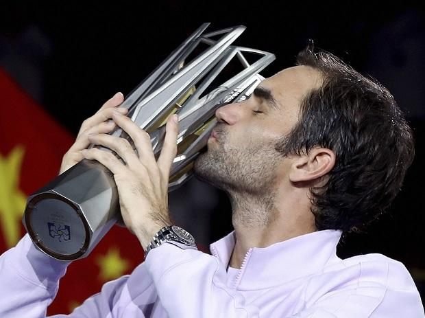 Roger Federer of Switzerland kisses his trophy after defeating Rafael Nadal of Spain in their men's singles final match to win the Shanghai Masters. Photo: AP/PTI