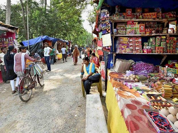 Firecrackers on sale in a market ahead of Kali Puja and Diwali festival at Champahati in South 24 Parganas on Sunday. Photo: PTI