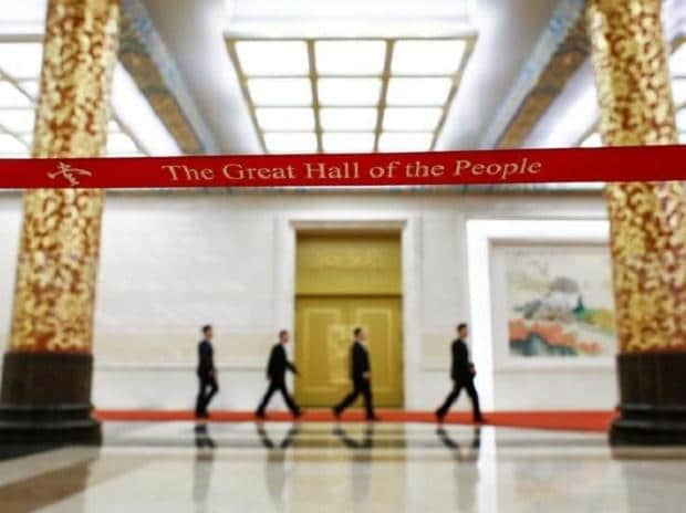 Communist Party spokesman Tuo Zhen and other officials arrive at a media briefing one day ahead of the opening of the 19th National Congress of the Communist Party of China, at the Great Hall of the People in Beijing