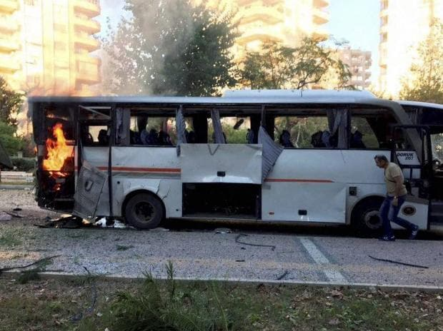 A bus carrying police officers still burning shortly after a bomb went off as the bus was passing by in Mersin in southern Turkey. (Photo: AP| PTI)