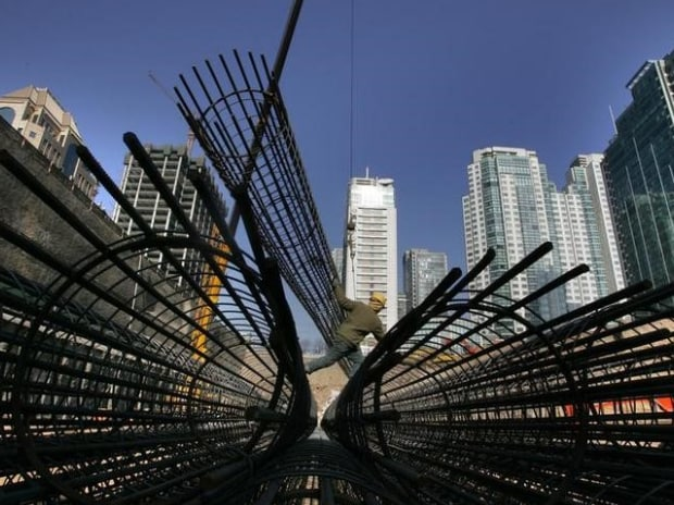 A Chinese man works at a construction site in the Central Business District of China's capital Beijing. (Photo: Reuters)