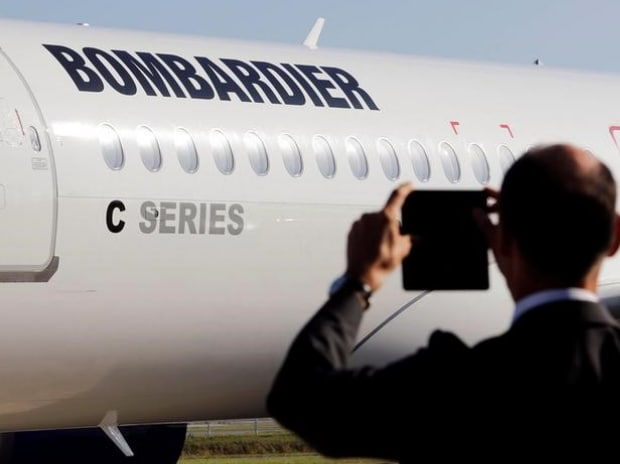 A man takes a picture of a Bombardier CSeries aircraft during a news conference to announce a partnership between Airbus and Bombardier on the C Series aircraft programme. (Photo: Reuters)