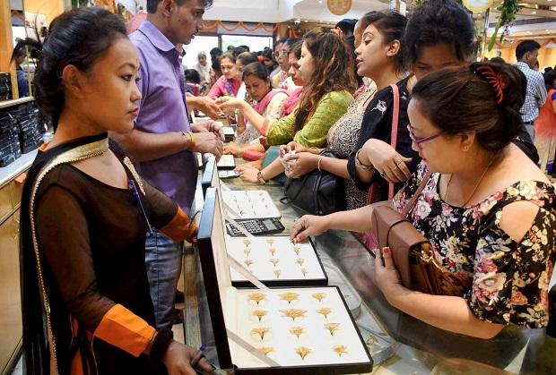 Guwahati : Women buying gold jewellery at a shop on the occasion of Dhanteras in Guwahati on Tuesday. Photo: PTI