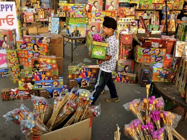 A child buying firecrackers on the eve Diwali festival, in Amritsar. (Photo: PTI)