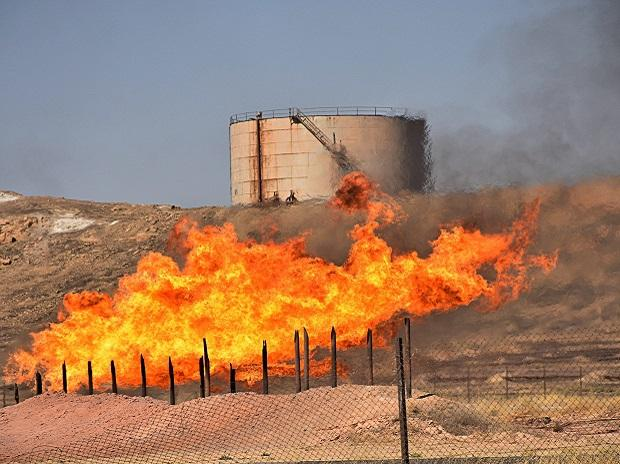 Fires flare off the gas from in Kirkuk, Iraq. Photo: AP/PTI