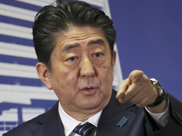 Japan's Prime Minister Shinzo Abe points to a reporter during a press conference at his Liberal Democratic Party headquarters in Tokyo. Photo: AP/PTI