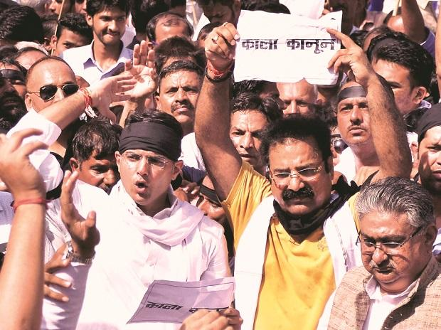 Congress leader Sachin Pilot with party workers stage protest at the Rajasthan Assembly in Jaipur on Monday