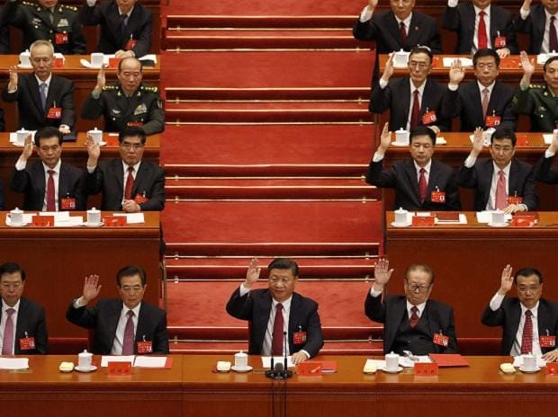 Chinese President Xi Jinping, front row center, leads other cadres to raise their hands to show approval of work reports during the closing ceremony for the 19th Party Congress at the Great Hall of the People in Beijing. (Photo: AP| PTI)