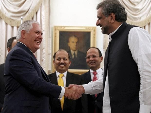 US Secretary of State Rex Tillerson shakes hands with Pakistani Prime Minister Shahid Khan Abbasi, before their meeting at the Prime Minister's residence in Islamabad. (Photo: AP|PTI)