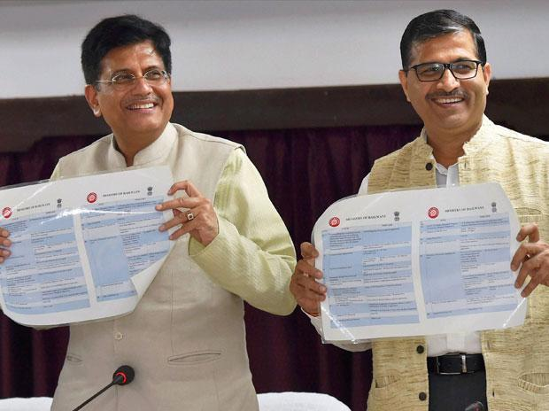 Railway Minister Piyush Goyal (L) with Chairman of the Railway Board Ashwani Lohani releases a brochures during a press conference in New Delhi.