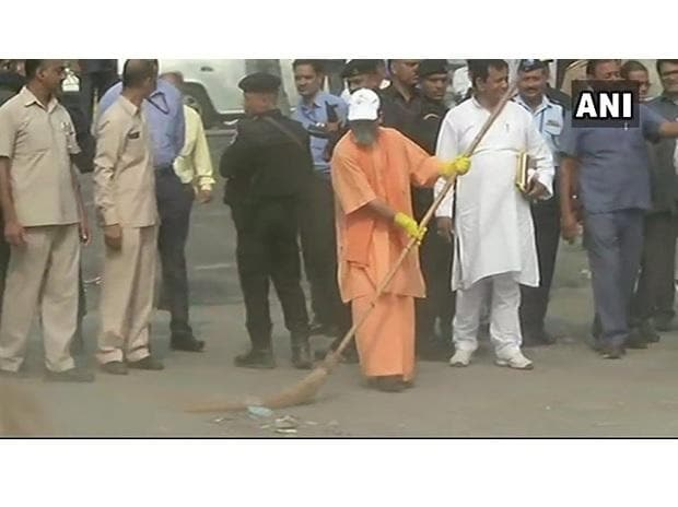 Chief Minister Yogi Adityanath takes part in cleanliness drive at the Western Gate of Taj Mahal. Photo: @ANINewsUP