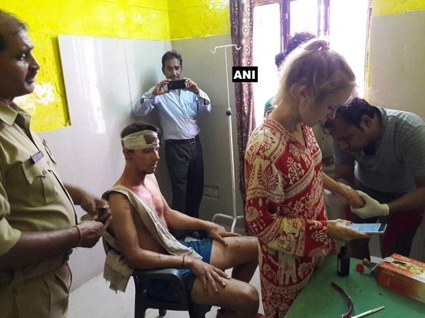Swiss couple attacked by unknown people in Fatehpur Sikri. Photo: @ANINewsUP