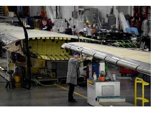 A worker inspects a C Series aeroplane wing in the Bombardier factory in Belfast, Northern Ireland. Photo: Reuters
