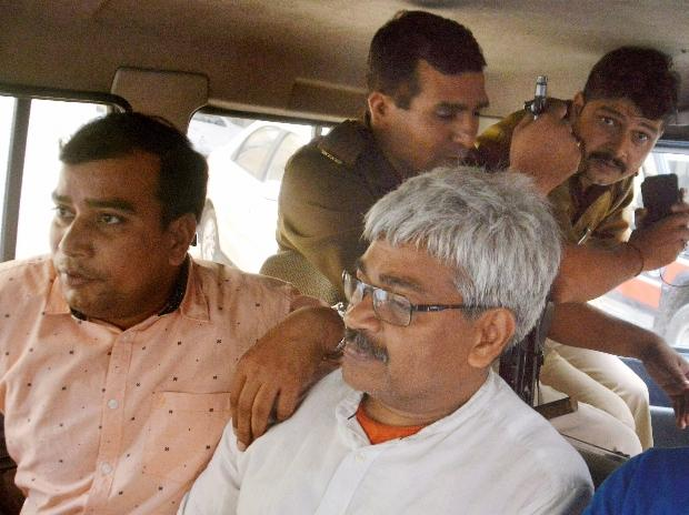 Senior journalist Vinod Verma being arrested by Chhattisgarh Police from his Ghaziabad residence over charges of blackmail and extortion in Ghaziabad. (File Photo)