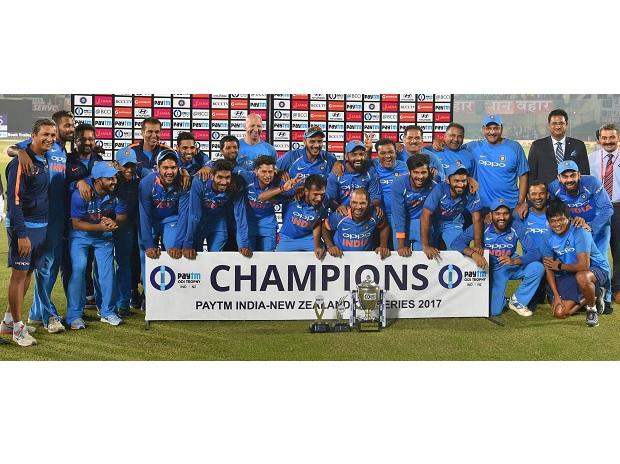 Indian team celebrate their victory with the winning trophy after the 3rd and final ODI cricket match against New Zealand at Kanpur. Photo: PTI