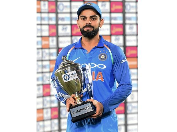 Indian captain Virat Kohli holds the winner's trophy after beating New Zealand in the 3rd ODI at Kanpur. Photo: PTI