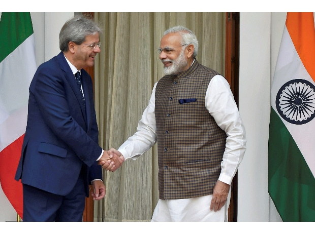Prime Minister Narendra Modi shakes hands with his Italian counterpart Paolo Gentiloni prior to their luncheon talks at Hyderabad House in New Delhi. (Photo: PTI)