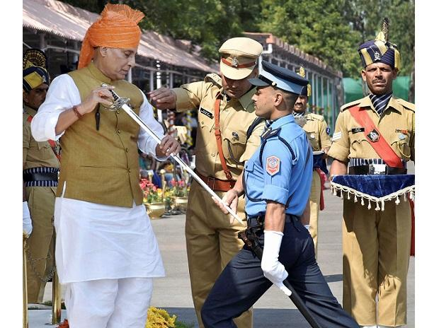 Union Home Minister Rajnath Singh presenting the sword of  honour to Rajesh Raj Puri (NPS) at the passing out parade at Sardar Vallabhbhai Patel National Police Academy. Photo: PTI