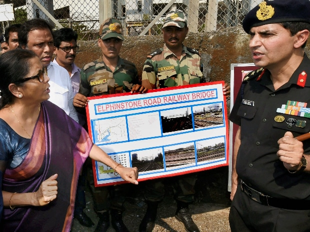 Defence Minister Nirmala Sitharaman interacts with an army officer while visiting the Elphinstone Station in Mumbai. (Photo: PTI)