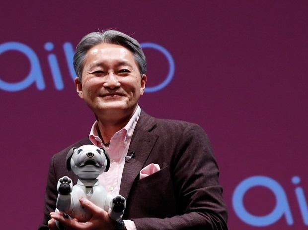 Sony's President and CEO  Kazuo Hirai holds entertainment robot