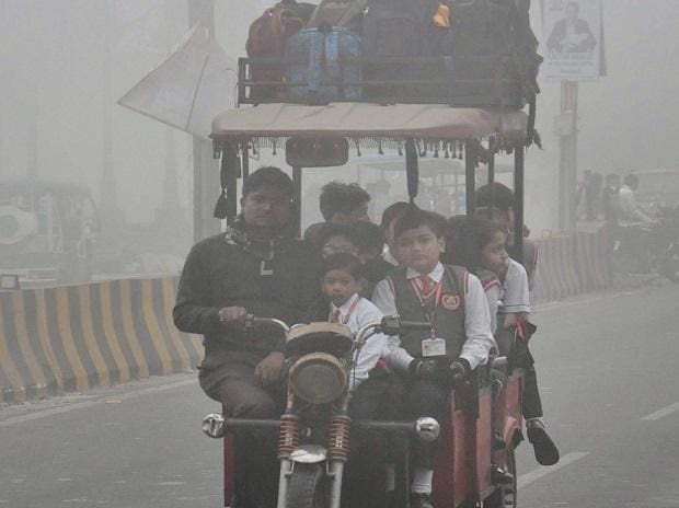 Students, clad in winter uniforms, on their way to school