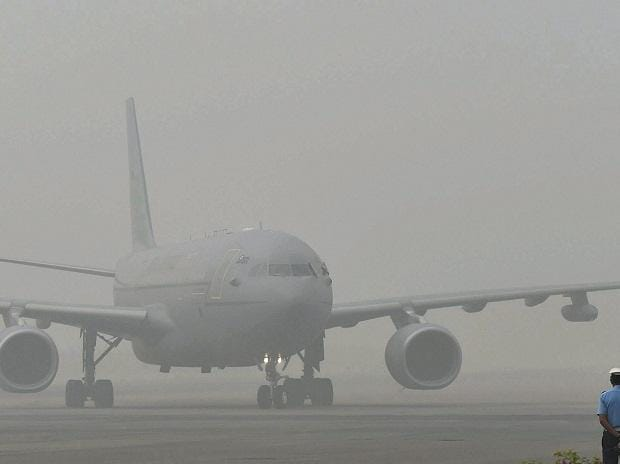 The plane of Britain's Prince Charles in surrounded by smog at Air Force Station Palam in New Delhi on Wednesday. Photo: PTI