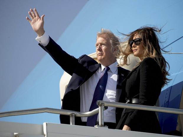 US President Donald Trump and first lady Melania Trump board Air Force One at Osan Air Base in Pyeongtaek. Photo: AP/PTI