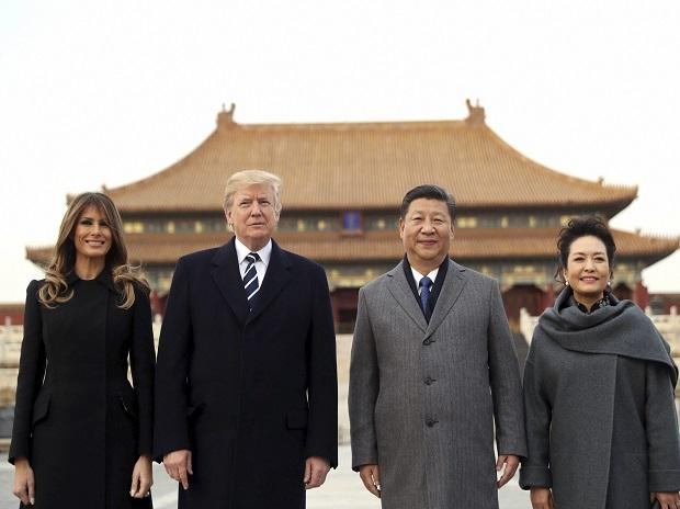President Donald Trump, second left, first lady Melania Trump, left,  Chinese President Xi Jinping, second right, and his wife Peng Liyuan, right, stand together as they tour the Forbidden City. Photo: AP/PTI