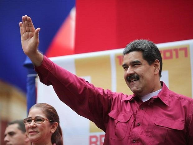 Venezuela's President Nicolas Maduro waves as he arrives for a rally with supporters in Caracas, Venezuela. Photo: Reuters