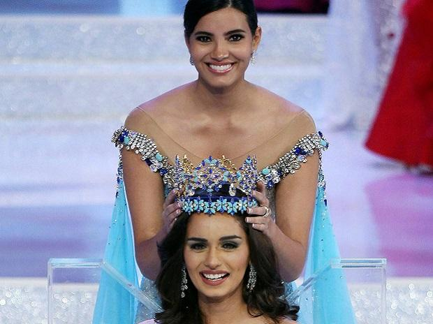 India's Manushi Chillar, centre, reacts at the beauty pageant where she is crowned Miss World in Sanya in southern China's Hainan province. (File Photo: PTI)