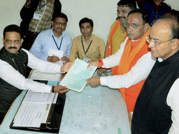 Gujarat Chief Minister Vijay Rupani filing his nomination papers for the state assembly election, in presence of Union Finance Minister Arun Jaitley in Rajkot.