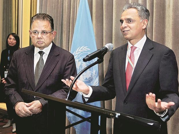 India's Permanent Representative to the United Nations Syed Akbaruddin speaks during a reception in the honour of Justice Dalveer Bhandari (left) at the UN in New York. Photo: PTI