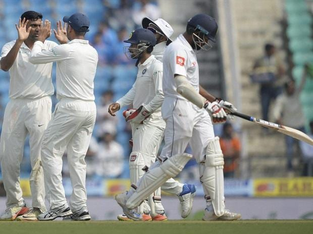 Indian bowler R Ashwin celebrate with his teammates after getting wicket of Sri Lankan batsman Lahiru Thirimanne during their 2nd cricket test match in Nagpur on Friday. Photo: PTI