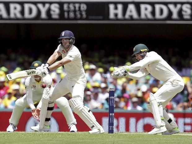 Brisbane: England's Dawid Malan plays a shot as Australia's wicket keeper Tim Paine, right, looks on during the Ashes cricket test between England and Australia in Brisbane, Australia. (Photo: AP/PTI)