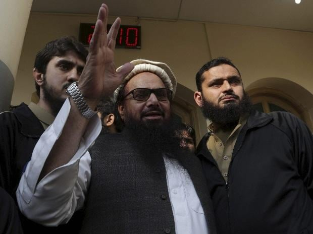 Hafiz Saeed, founder of terrorist organistaion Lashkar-e-Taiba and the chief of JuD, waves to his supporters at a mosque in Lahore, Pakistan. (File Photo)