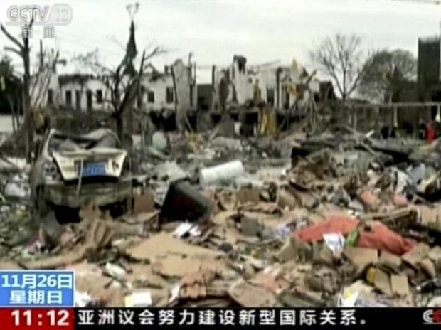 Ningbo : In this image from video run by China's CCTV, firefighters and people, right, walk near damaged buildings and vehicles following an explosion in Ningbo in east China's Zhejiang province. (Photo: AP/PTI)