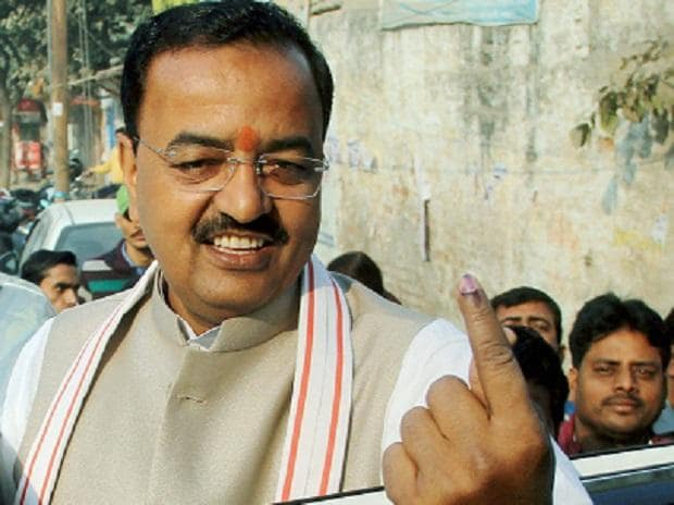 UP Deputy Chief Minister, Keshav Prasad Maurya shows his ink-marked finger after casting vote during second phase of municipal corporation elections at a polling station, in Allahabad. Photo: PTI)