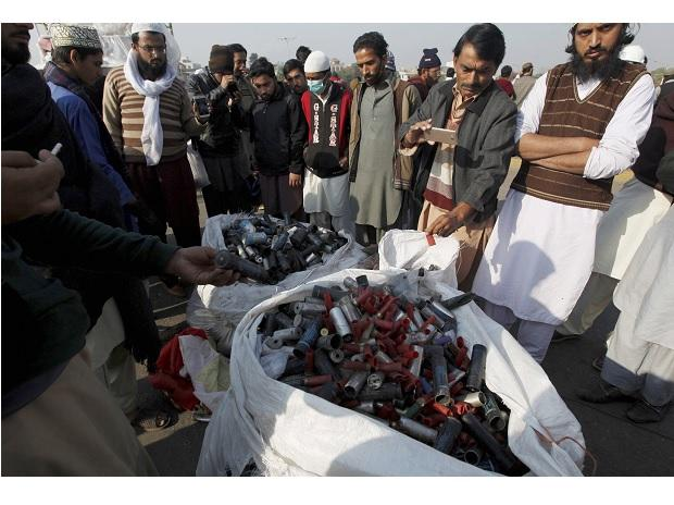 Islamabad : Supporters of a radical religious party, Tehreek-i-Labaik Ya Rasool Allah, gather around a pile of empty tear gas canisters and rubble bullets fired by police during clash, in Islamabad, Pakistan. (Photo: AP/PTI)