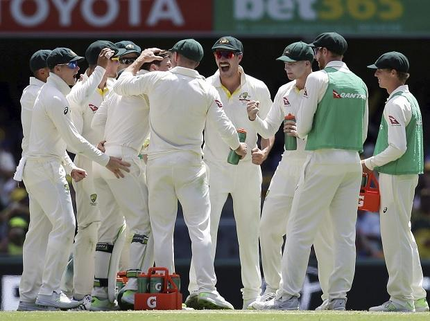 Brisbane : Australia celebrate the wicket of England's Moeen Ali, not shown, during the Ashes cricket test between England and Australia in Brisbane, Australia. (Photo: AP/ PTI)