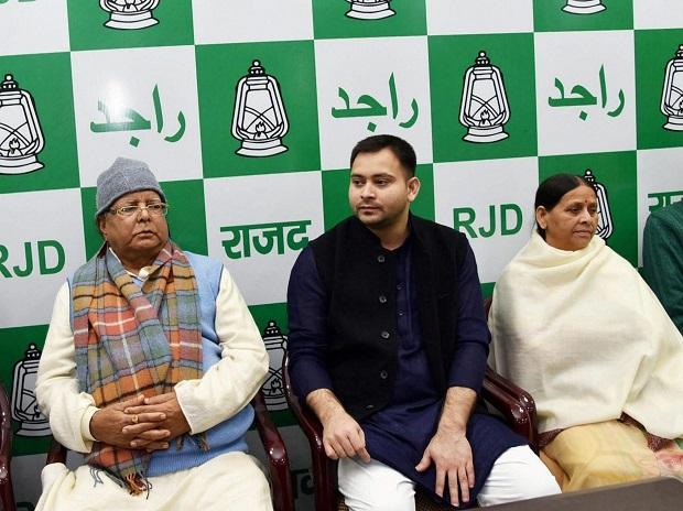 RJD chief Lalu Yadav along with senior leader Rabri Devi and leader of opposition Tejashwi Yadav during party legislator meeting in Patna. (Photo: PTI)