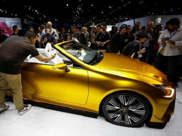 People look at a Lexus LF-C2 concept vehicle on display during the model's world debut at the Los Angeles Auto Show in Los Angeles. (Photo: PTI)