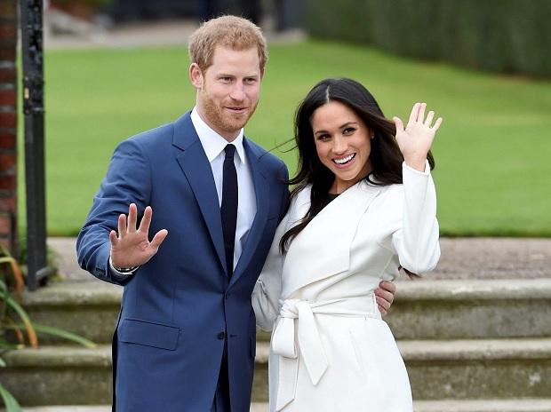 Britain's Prince Harry with his fiance Meghan Markle