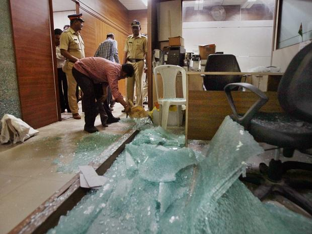 Police inspecting the Congress' office in Mumbai on Friday after it was ransacked by unknown miscreants. Photo: PTI