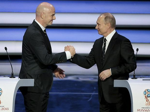 FIFA president Gianni Infantino, left, and Russian President Vladimir Putin shakes hands at the 2018 soccer World Cup draw in the Kremlin in Moscow, Friday, Dec. 1, 2017. AP/PTI