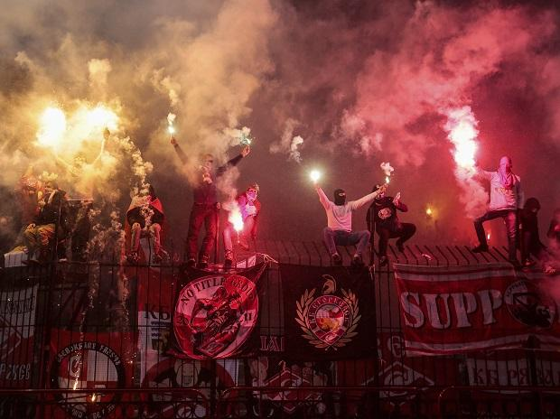 Russian soccer fans of Spartak team burn flares during a Russian Premier League Championship soccer match between Arsenal Tula and Spartak Moscow in Tula, about 200 kilometers (125 miles) south of Moscow. Photo: PTI