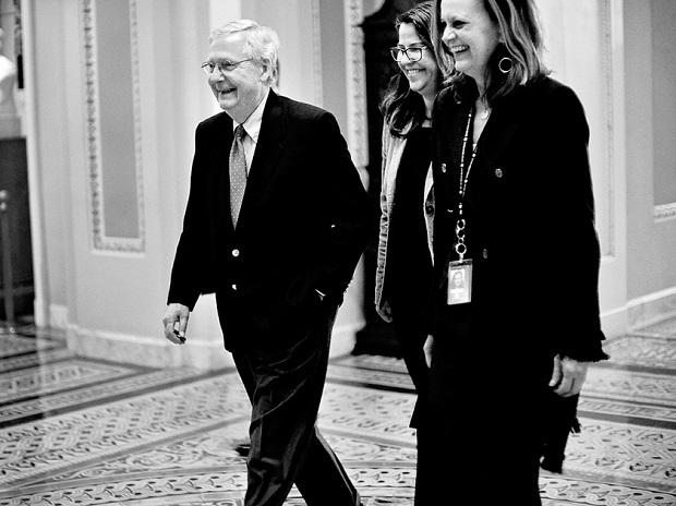 US Senate Majority Leader Mitch McConnell (extreme left) walks to the Senate floor as debate wraps up over the Republican tax reform plan in Washington. Photo: Reuters